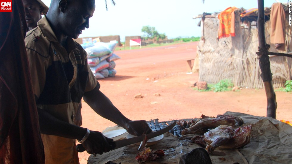 "Khoo took this photo of a stall selling goat meat as she was traveling in Mali's Dogon region in September 2010. ""We were at this eatery specifically to have a meal of goat barbecue ... for breakfast,"" she said. <br /><br />""One look at the goat leg hanging up in the blazing sun and I have to admit, I was a bit hesitant to try it but eventually I did take a few bites. Surprisingly, it wasn't bad -- the meat was fresh, simply grilled and lightly sprinkled with a spice mix of some sort."""