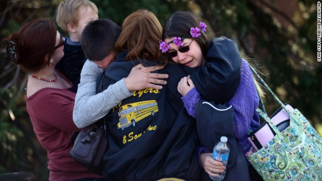 Parents and students embrace along School Road near Franklin Regional High School after more than a dozen students were stabbed by a knife wielding suspect at the school on Wednesday, April 9, 2014, in Murrysville, Pa., near Pittsburgh. The suspect, a male student, was taken into custody and is being questioned. (AP Photo/Tribune Review, Sean Stipp)  PITTSBURGH OUT