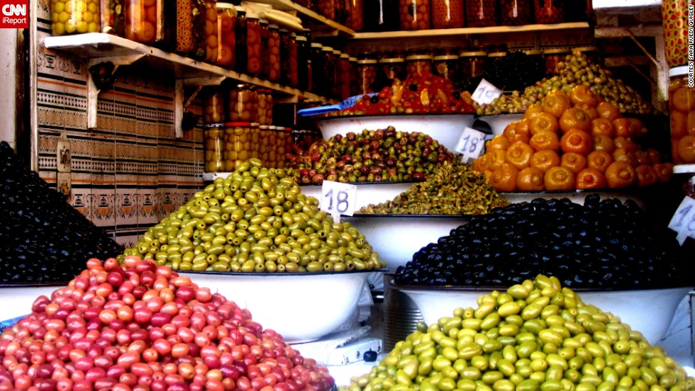 "Sara Ruedy Quigley from Richmond, Virginia, took this photo on a business trip in October 2011 at a souk in Marrakech, offering a huge choice of different olives. <br /><br />Despite the variety of food on offer, Sara also enjoyed something quite ordinary: ""It may seem simple, but bread is a great street food in Morocco. The breads are used to dip into tagines, olive oil dishes, or enjoyed alone with Morocco's famous mint tea. Steamed sheep head is a very popular street food, but I don't want to go anywhere near that."""