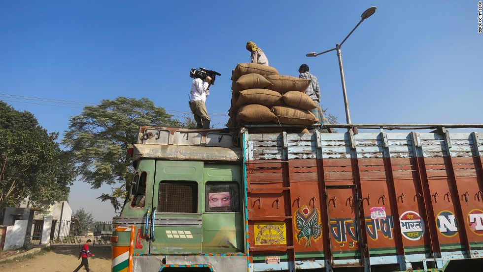 Sacks of grains are loaded onto a truck at a grain market in Amritsar.