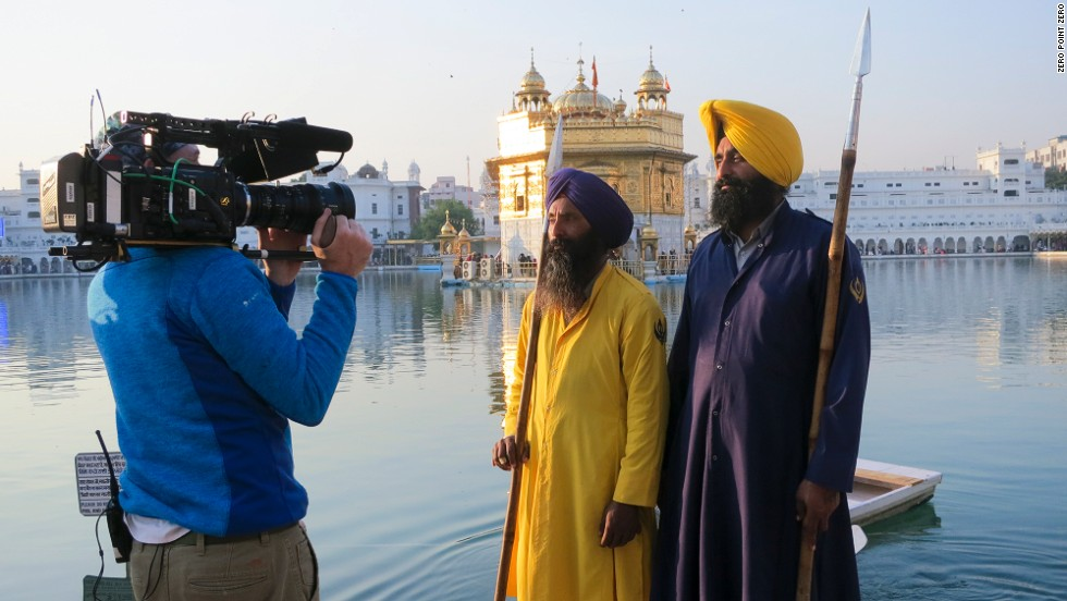 Two men are filmed outside the Golden Temple, a central place of worship for Sikhs in Amritsar, India.