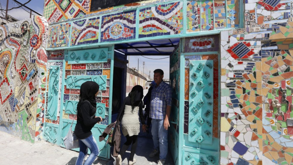 The mural is made from assorted scrap, such as pieces of ceramics and mirrors, soft-drink cans, pipes, cooking utensils, bicycle wheels and car parts.