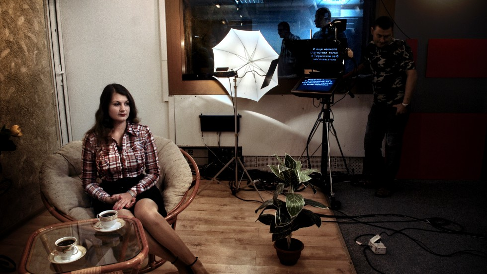 "A woman films a scene from ""Tea in the Morning,"" a show on state television in Transnistria."