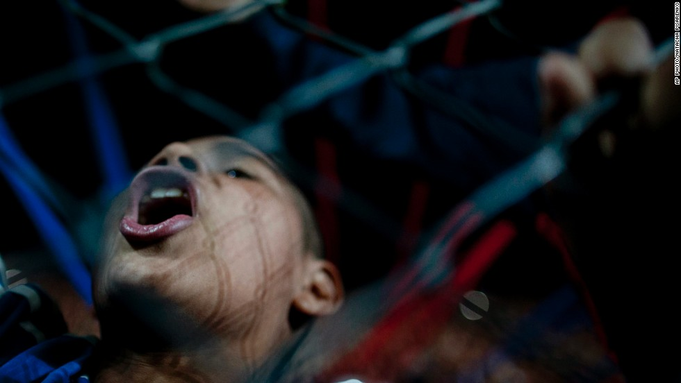 "APRIL 10 - BUENOS AIRES, ARGENTINA: A fan of Argentina's San Lorenzo cheers for his team before a Copa Libertadores soccer match against Brazil's Botafogo. With only two months until the World Cup begins in Brazil, the <a href=""http://edition.cnn.com/2014/04/02/sport/football/cfp-brazil-world-cup/"">host country is stepping up the final preparations</a>."