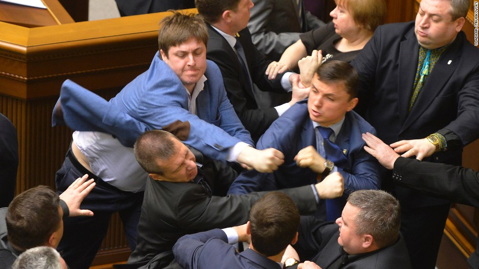 "Lawmakers scuffle during a parliament session in Kiev, Ukraine, on Tuesday, April 8. The fight broke out when Petr Simonenko, the leader of the Communist Party, began to say lawmakers should listen to the demands of eastern Ukraine. He defended demonstrators who have seized local government buildings, saying they are not doing anything different from what the current interim government has done. He also accused ""nationalists"" of starting <a href=""http://www.cnn.com/2014/03/26/world/gallery/ukraine-crisis/index.html"">the crisis in eastern Ukraine</a>."