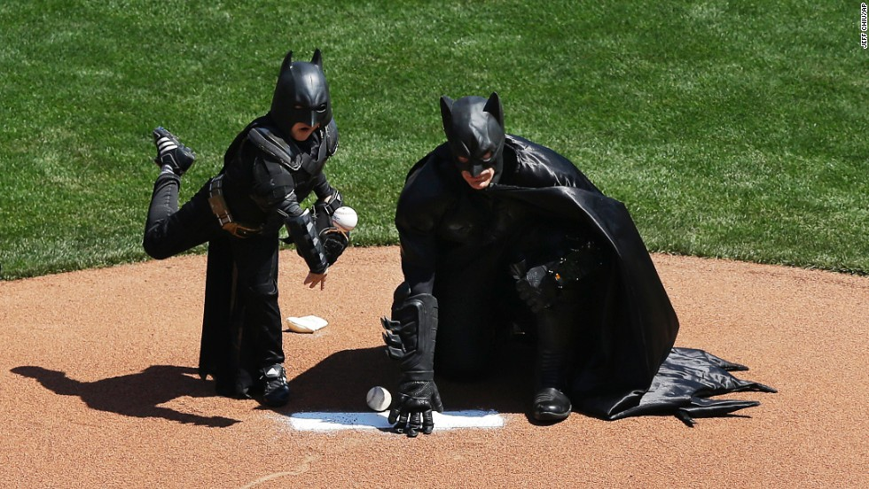 "Miles Scott, dressed as Batkid, <a href=""http://www.cnn.com/2014/04/09/us/gallery/batkid-throws-first-pitch/index.html"">throws the ceremonial first pitch</a> at the San Francisco Giants' home opener on Tuesday, April 8. Miles, a 5-year-old who has been fighting leukemia since he was a baby, made headlines in November when, through the Make-A-Wish Foundation, he became Batman for a day and got to ""save"" the city."