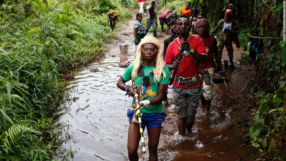"Members of a Christian militia patrol outside the village of Zawa in the Central African Republic on Tuesday, April 8.  The Central African Republic, a former French colony, was <a href=""http://www.cnn.com/2014/04/10/world/africa/un-central-african-republic/index.html"">plunged into chaos</a> last year after a coalition of mostly Muslim rebels ousted President Francois Bozize. They have since been forced out of power, but Christian and Muslim militias continue to fight for control."