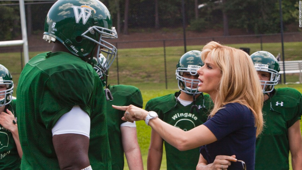 "In this scene from 2009's ""The Blind Side,"" Quinton Aaron, playing Michael Oher, is ""coached"" by Sandra Bullock as Leigh Anne Tuohy. Bullock's Oscar cemented her A-list status."