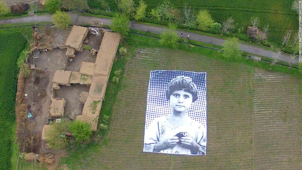 "An art installation featuring a large-scale portrait of a child reportedly orphaned by a drone strike was unveiled this week in the Khyber Pakhtunkhwa area of northwest Pakistan. The project is meant to be seen from above by drone operators and aims to raise awareness about civilian casualties. The collaborative effort was inspired by French artist JR's ""Inside Out"" movement."