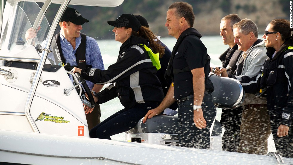 William, left, hangs on as Catherine drives a boat to Westpark Marina in Auckland, New Zealand, on Friday, April 11.