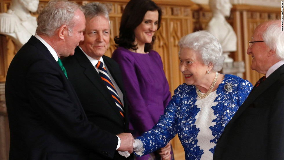 Queen Elizabeth II greets Northern Ireland Deputy First Minister Martin McGuinness, left, and First Minister Peter Robinson, second from left, and Theresa Villiers, Britain's secretary of state for Northern Ireland, during a reception at Windsor Castle on Thursday, April 10. Higgins is at the right at the Northern Ireland-themed event.