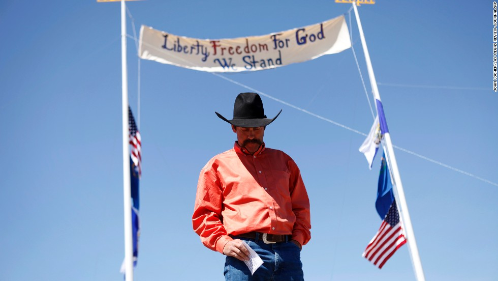 Rancher Derrel Spencer speaks during a rally in support of Bundy on April 7.