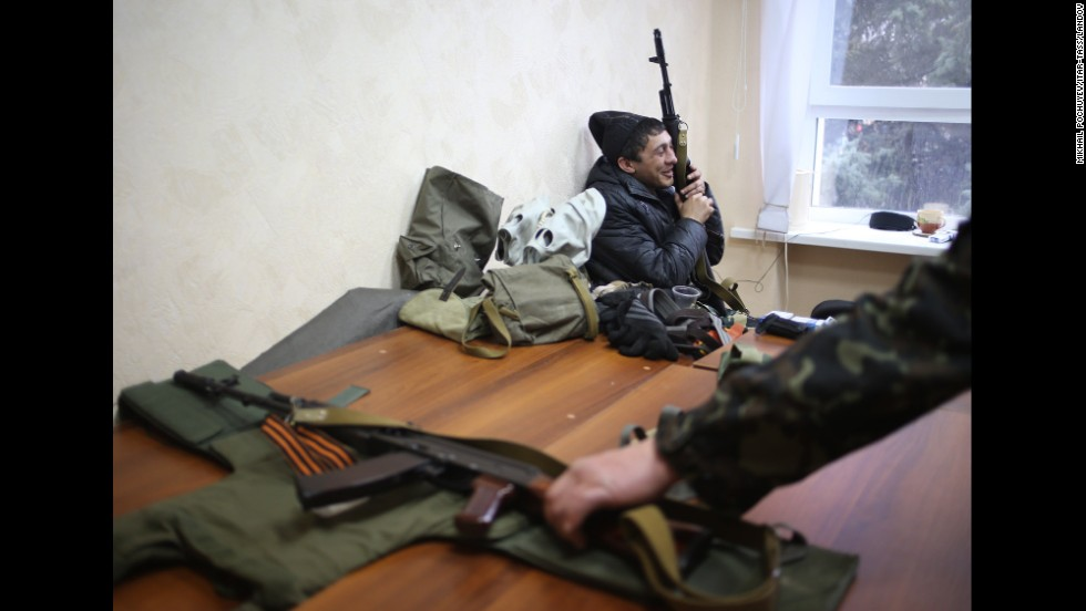 Armed pro-Russian protesters occupy the Security Service building in Luhansk on April 10.