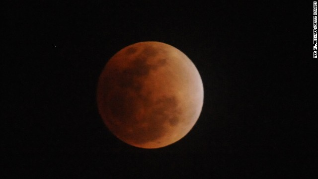Total lunar eclipse as seen in Manila on December 10, 2011. A lunar eclipse occurs when the moon, following its orbit around Earth, passes directly behind our planet as seen from the sun