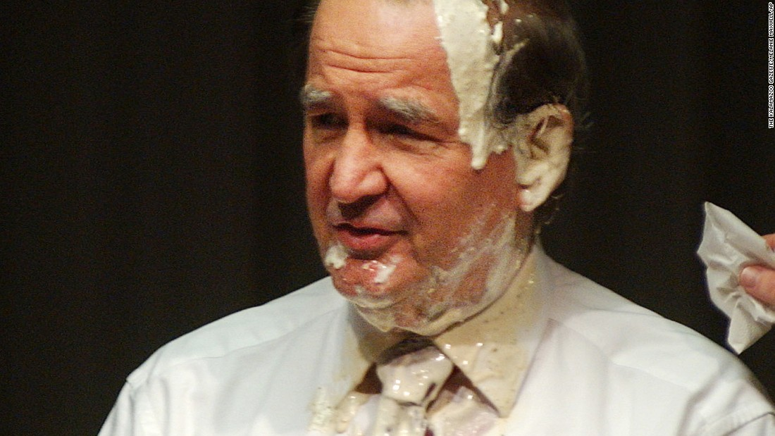 "Conservative commentator and former presidential candidate Pat Buchanan was doused with salad dressing on his face in 2005 after a man rushed the podium while he was speaking at Western Michigan University in Kalamazoo, Michigan.  Buchanan cut short his Q & A session with the audience saying, ""Thank you all for coming, but I'm going to have to get my hair washed."""