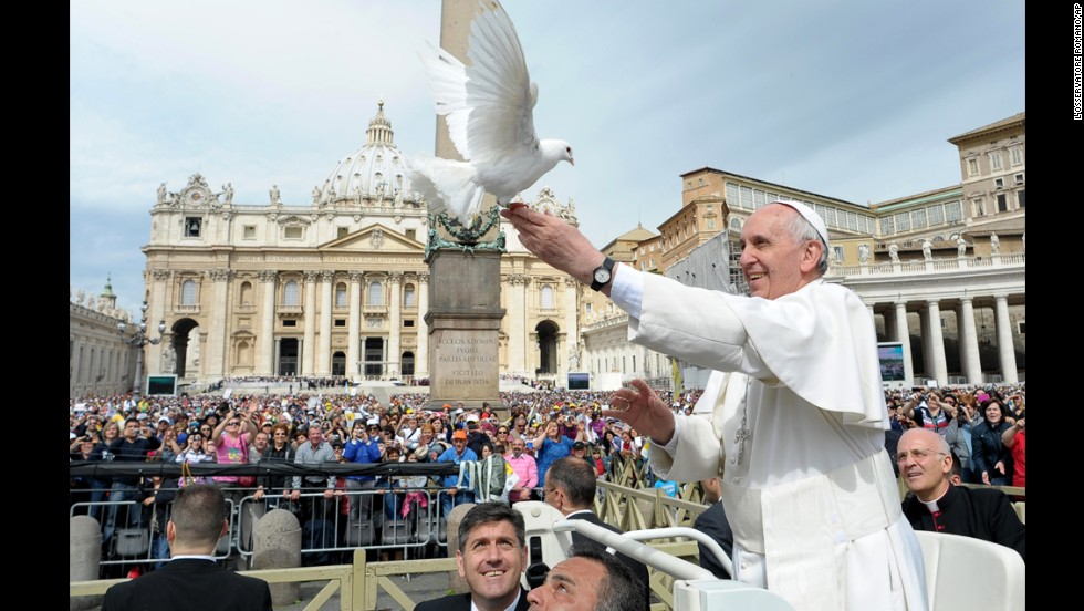 Francis frees a dove in May 2013 during his weekly general audience in St. Peter's Square.