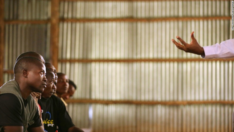Teacher Alphonse Senyoni leads a class on history, politics and the 1994 genocide for former Democratic Forces for the Liberation of Rwanda combatants in Mutobo on April 10.