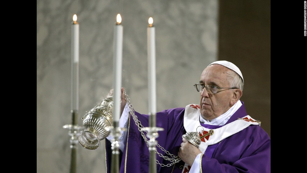 The Pope blesses the altar at Rome's Basilica of Santa Sabina as he celebrates Mass on Ash Wednesday in March 2014.