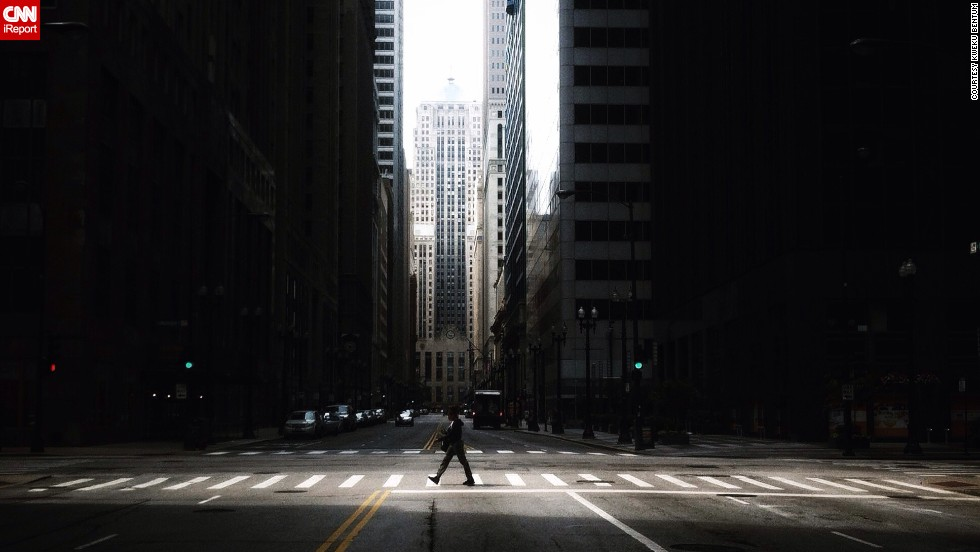 "A <a href=""http://ireport.cnn.com/docs/DOC-1119013"">lone walker</a> crosses an urban canyon on LaSalle Street."
