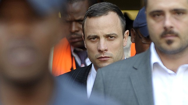 South African Paralympic track star Oscar Pistorius (C) leaves the North Gauteng Hight Court in Pretoria on April 11, 2014, during his ongoing murder trial. The prosecution angrily accused Oscar Pistorius of tailoring evidence and overplaying his deep fear of crime on April 11 to justify shooting dead his girlfriend Reeva Steenkamp. AFP PHOTO / MUJAHID SAFODIENMUJAHID SAFODIEN/AFP/Getty Images