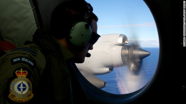 AT SEA - APRIL 11: FLTLT Jamin Baker, a crew member on a Royal New Zealand Air Force P-3 Orion, on lookout during the search to locate missing Malaysia Airways Flight MH370 at sea over the Indian Ocean on April 11, 2014 off the coast of Western Australia. Search and rescue officials in Australia are confident they know the approximate position of the black box recorders from missing Malaysia Airlines Flight MH370, Australian Prime Minister Tony Abbott said on Friday. At the same time, however, the head of the agency coordinating the search said that the latest 'ping' signal, which was captured by a listening device buoy on Thursday, was not related to the plane. (Photo by Richard Wainwright - Pool/Getty Images)
