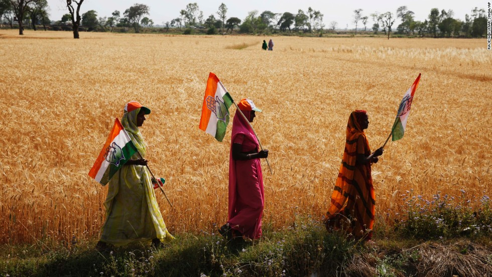 Congress Party supporters hold flags as they walk home from a Gandhi rally April 12 in the northern state of Uttar Pradesh.