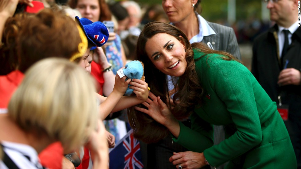 A young child shows his toy to the duchess in Cambridge, New Zealand, on April 12.