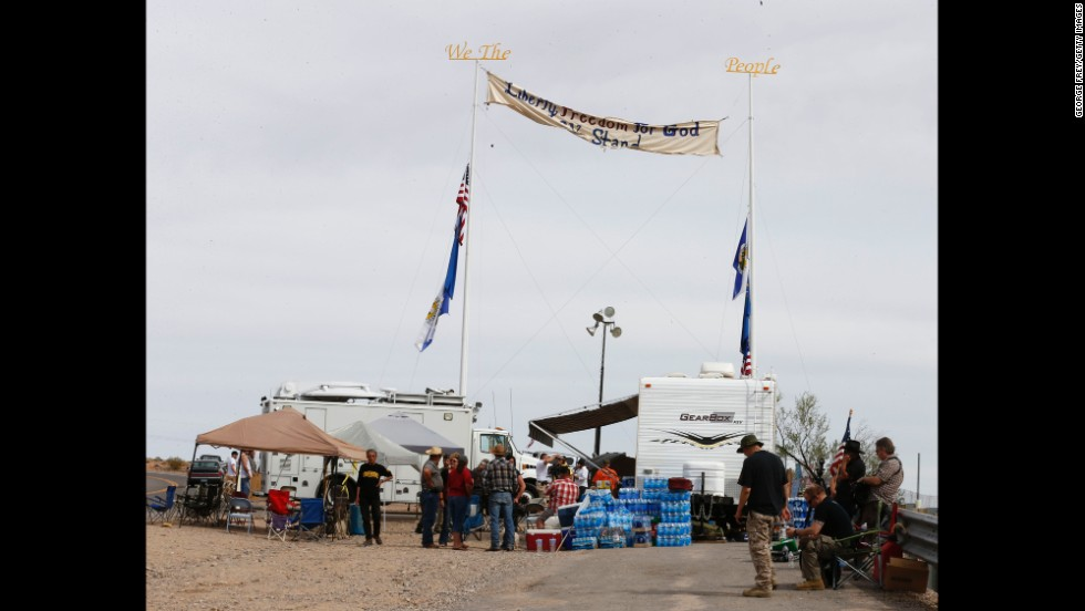 People gather at a protest area along State Route 170, near the cattle roundup on April 11.