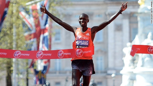 Wilson Kipsang crosses the line in triumph at the 34th London Marathon in a new course record time.