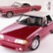 27,mustang.1990 and 1965 Ford Mustang convertibles neg CN54324-15