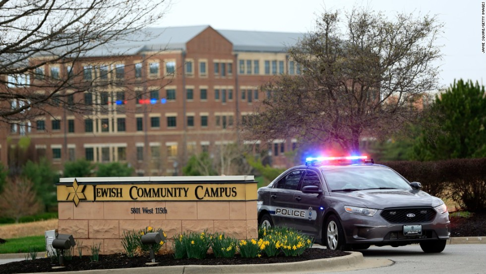A police car is seen at the entrance of the Jewish Community Center on April 13.