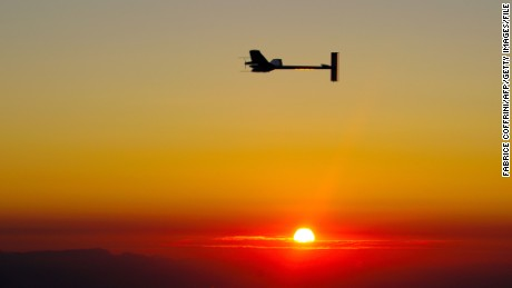 Experimental aircraft 'Solar Impulse' with pilot Andre Borschberg onboard flies at sunrise above Payerne's Swiss airbase on July 8, 2010 during the first attempt to fly around the clock fuelled by nothing but the energy of the sun. The solar powered aircraft was flying in circles high over Switzerland at first light well on its way to completing a historic round the clock flight. AFP PHOTO / FABRICE COFFRINI (Photo credit should read FABRICE COFFRINI/AFP/Getty Images)