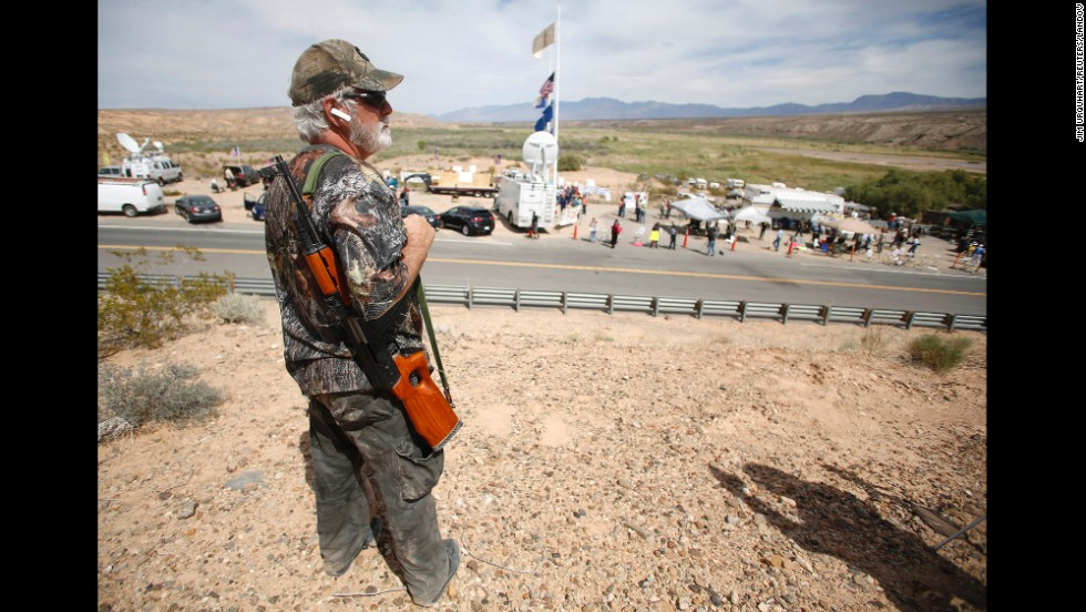Brand Thornton carries a rifle at a protest site in Bunkerville on April 11. The controversy drew armed militia groups from across the country to Bundy's side. The Bureau of Land Management stopped rounding up Bundy's cattle on Saturday, April 12, and it says it returned about 300 head of cattle to the open range to avoid the potential for violence.