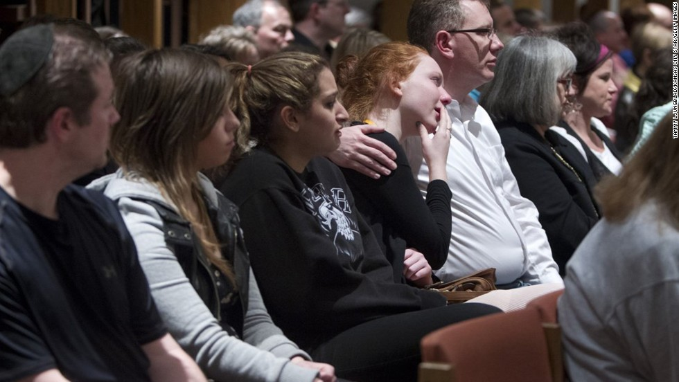 People gather to mourn the shooting victims April 13 at St. Thomas the Apostle, an Episcopal church in Overland Park. Overland Park is a suburb of Kansas City.