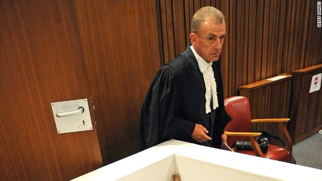 State prosecutor Gerrie Nel walks past the reconstruction of the bathroom where Reeva Steenkamp was shot by Oscar Pistorius on April 14, 2014 in Pretoria, South Africa.