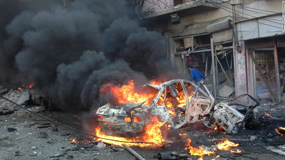 Flames engulf a vehicle following a car bomb Wednesday, April 9, in the Karm al-Loz neighborhood of Homs.