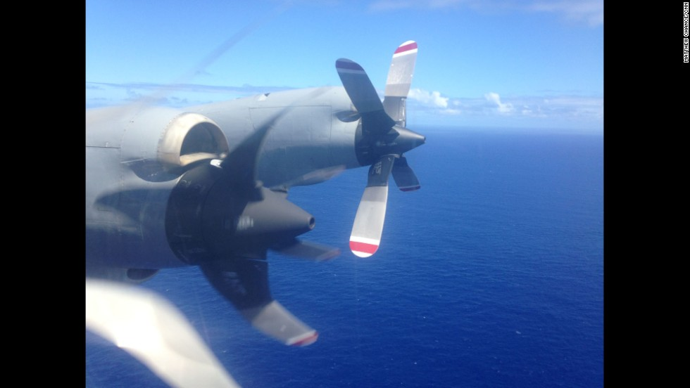 """""""1, 000 miles from land, one of four engines is switched off in an effort to preserve fuel and remain in the search area for a longer period of time. P3 Orions on the MH370 search missions have enough fuel to fly three hours to the search area, allowing five hours of search time before having to fly three hours back to RAFF Base Pearce.""""  By CNN's Matthew Chance, Southern Indian Ocean, April 11."""