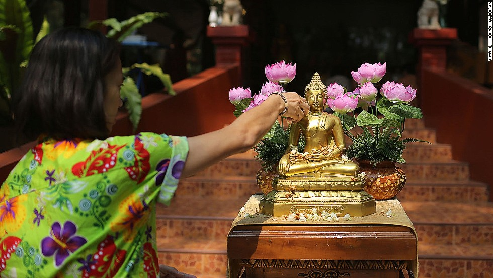 On the first day of festivities, families and friends celebrate by visiting temples and pouring water on each others' hands as a blessing. People also pour water -- seen as a way of washing away bad luck -- over Buddha statues.
