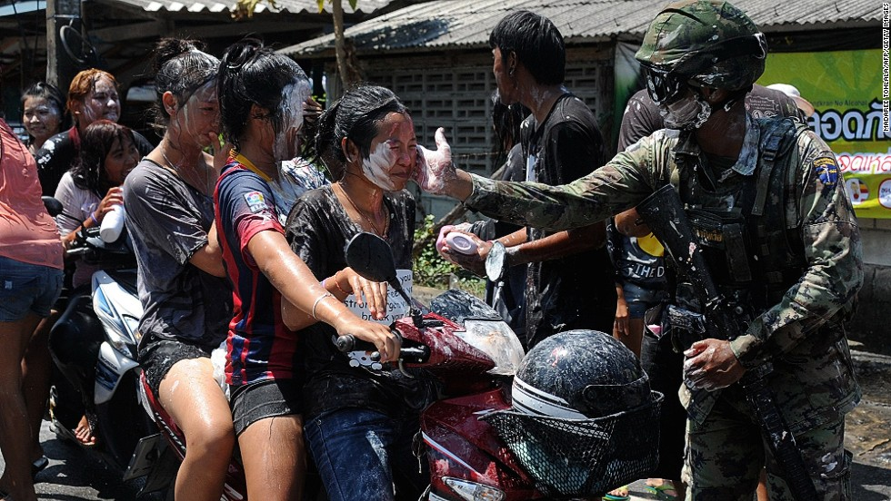 A Thai soldier gets in on the Songkran act in Thailand's southern Narathiwat Province.