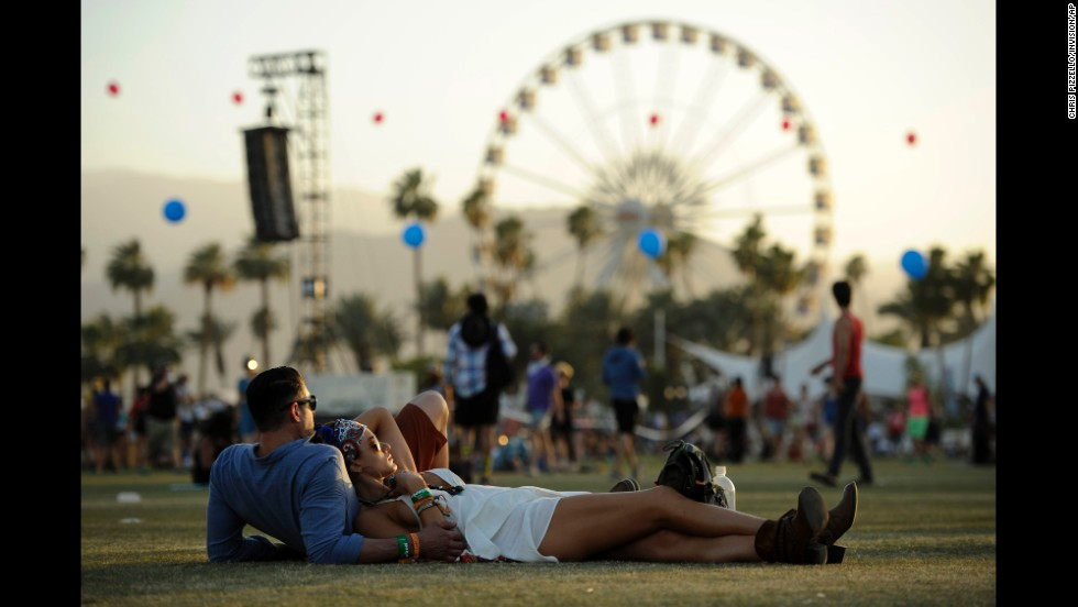 Justin Gibbs and Olivia Hansen relax Sunday, April 13, during the Coachella Valley Music and Arts Festival in Indio, California.