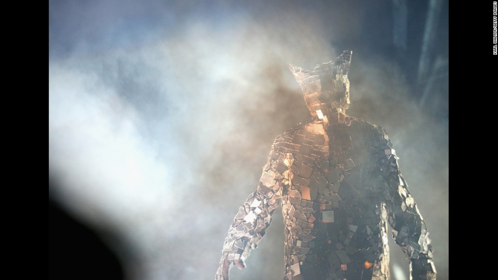 """Reflektor man"" is seen in the audience during the Arcade Fire performance on April 13."
