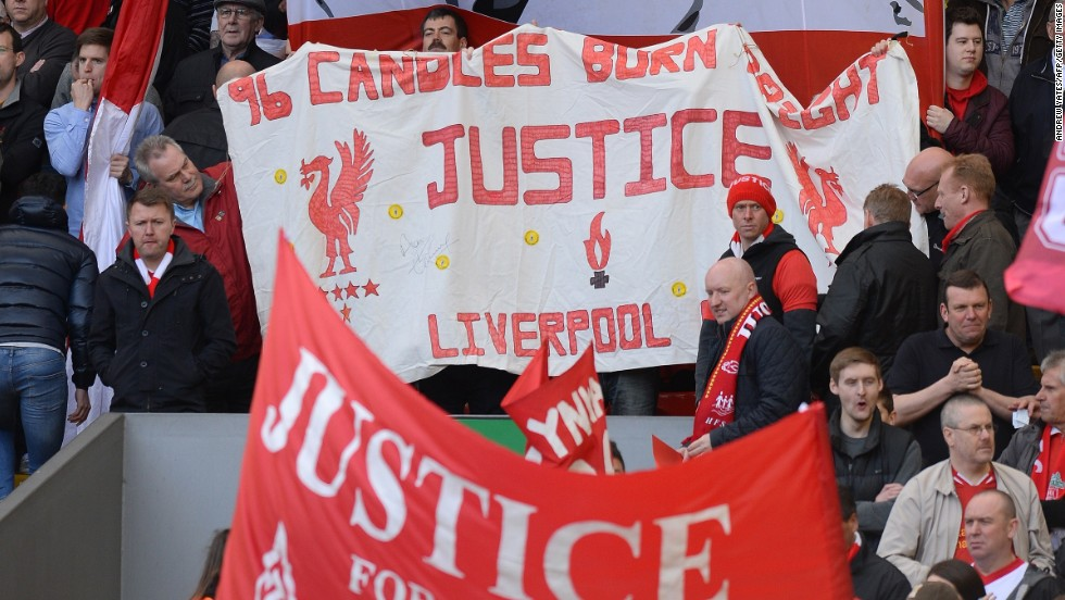 Fans in the Kop stand at Anfield display banners in memory of the Hillsborough victims.