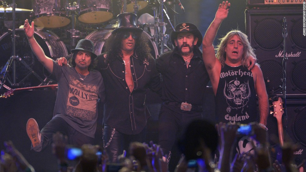 Guitarist Slash, second from left, appears on stage with Motorhead on April 13.