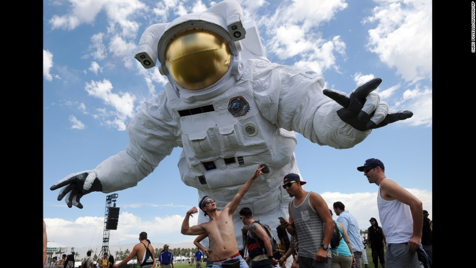 "Coachella festivalgoers are dwarfed by the ""Escape Velocity"" moving sculpture on the Empire Polo Field during day one of the 2014 Coachella Music and Arts Festival on Friday, April 11."