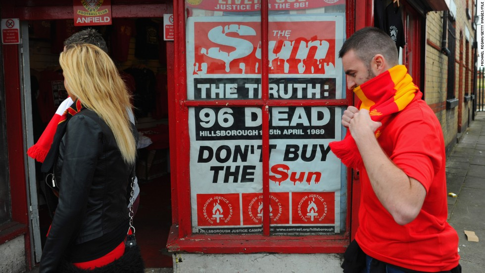 "A poster protesting about the way in which Liverpool fans were blamed for Hillsborough is displayed outside Anfield in 2012. The club's supporters boycotted, and continue to boycott, ""The Sun"" newspaper due to its coverage of the deaths. In the aftermath of the Hillsborough Independent Panel report that year, the paper issued an apology for what it said were ""false reports."""