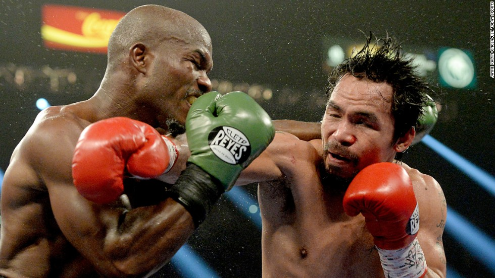 Timothy Bradley, left, and Manny Pacquiao clash during their welterweight title fight in Las Vegas on Saturday, April 12. Pacquiao won by unanimous decision, avenging a controversial loss to Bradley in 2012.