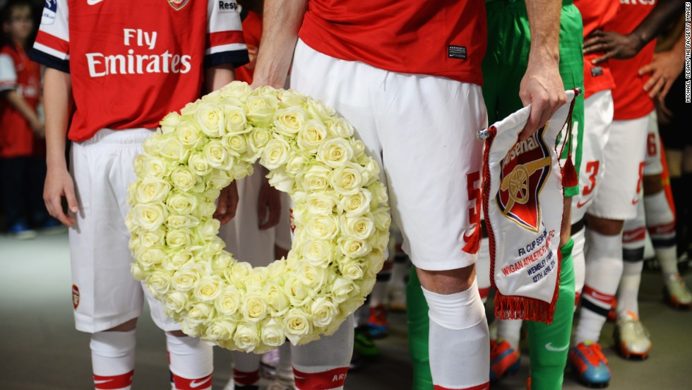 Prior to the FA Cup semifinal match between English soccer clubs Arsenal and Wigan Athletic, Arsenal captain Thomas Vermaelen holds a commemorative wreath to mark the 25th anniversary of the Hillsborough disaster. In 1989, before an FA Cup semifinal, 96 fans of Liverpool Football Club were crushed to death by an overflow at Hillsborough Stadium in Sheffield, England.