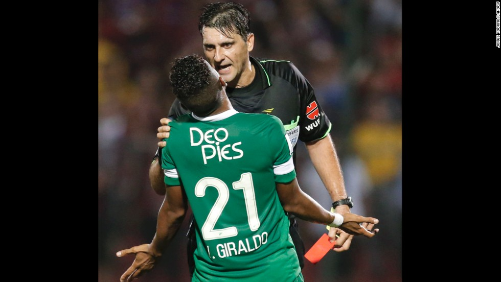 Victor Hugo Giraldo, a soccer player with Colombian club Deportivo Cali, protests a penalty called by referee Dario Ubriaco during a Copa Libertadores match Tuesday, April 8, against Paraguayan club Cerro Porteno. Cerro Porteno won the match 3-2 in Asuncion, Paraguay, advancing to the knockout stage of the tournament.