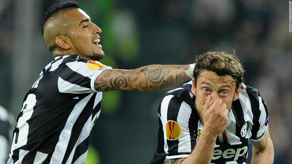 Juventus midfielder Claudio Marchisio, right, celebrates with teammate Arturo Vidal after scoring a goal against Lyon during the second leg of their Europa League quarterfinal Thursday, April 10, in Turin, Italy. Juventus won the game 2-1 and advanced to the semifinals of the European soccer tournament.