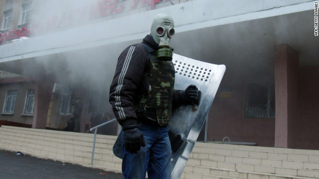 A pro-Russia protester takes part in the storming of regional police building in the eastern Ukrainian city of Horlivka (Gorlovka), near Donetsk, on April 14, 2014. A